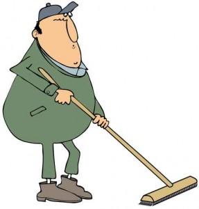 Man using a push broom